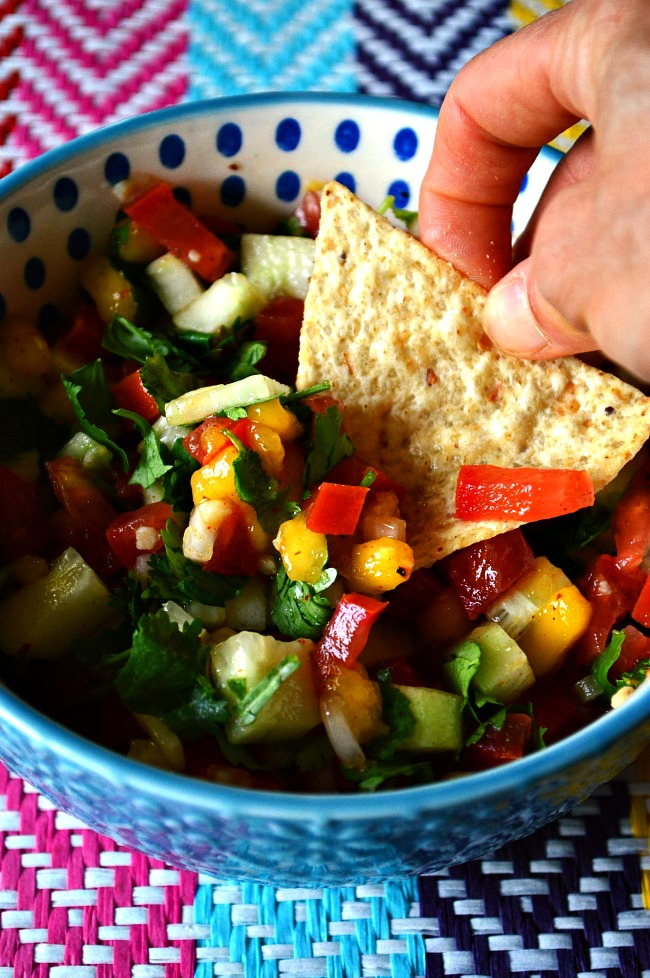 Summer shines through in this tangy and tasty Cucumber Mango Salsa. Eat it up for a refreshing snack in the middle of those hot summer days.