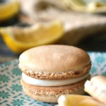 These Gluten Free Lemon Curd Macarons are soft, pillowy bites of heaven; light and airy vanilla macarons sandwiched with a fresh lemon curd and a lemon zest buttercream. A taste of spring!