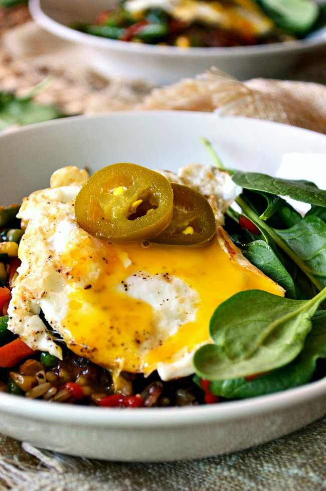 Wake up to a super simple yet surprisingly satisfying Gluten Free Lentil Veggie Breakfast Bowl. With frozen veggies and ready to go lentils and rice, this breakfast couldn't get any easier. All you gotta do is fry the egg!