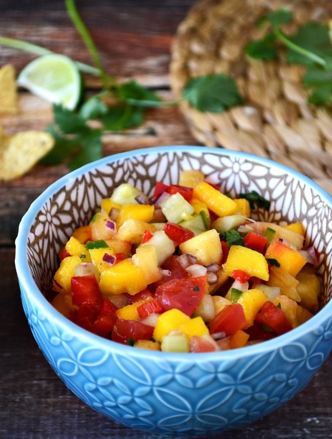 Add a tropical twist to your tacos with this Honey Lime Tropical Cucumber Salsa. There's some tang, some spice, some crunch, and some sweetness to this perfect pico. Grab a chip and scoop away!