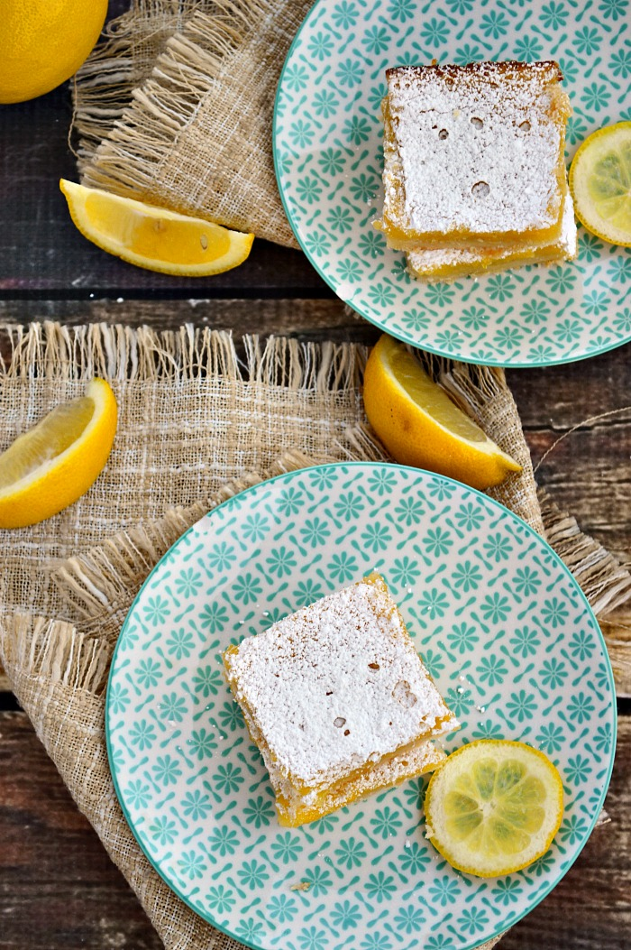 Jump into summer with the best ever batch of Gluten Free Lemon Bars. Fresh squeezed lemon juice, lemon zest, and a buttery crust make these the perfect party treat.