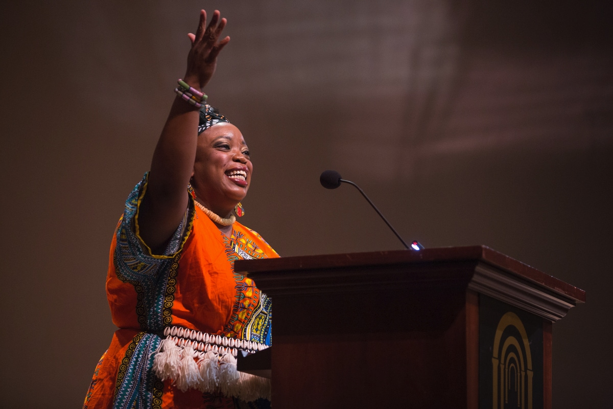 """Madia Cooper-Ashirifi, visiting assistant professor of dance, introduces a musical and dancer performance of """"Fanga Alafia"""" during the Martin Luther King Jr. Day Convocation."""