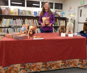 Malad Idaho, Oneida County Library, Author night, Books with author and 2 felted animals, alpaca and sheep, Ernie and Reno