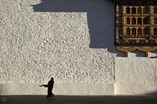 Monk walking in monastery, Bhutan