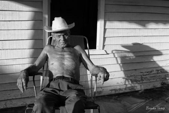 Cuban Man Relaxing on Front Porch, Viñales, Cuba.