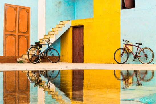 Bicycles, trompe l'oeil, and reflections, Trinidad, Cuba.