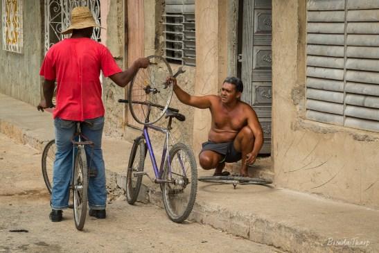 Reparing bicycles in Trinidad, Cuba.