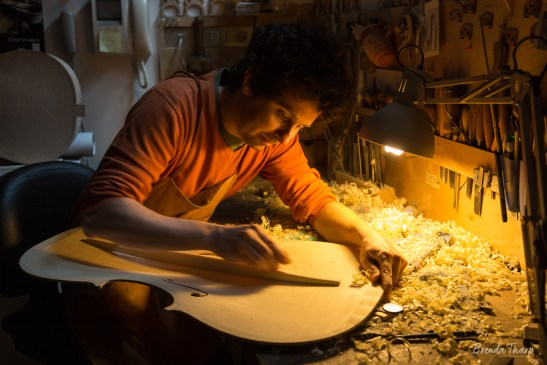 Violin-maker works on a violin.