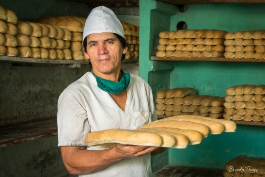 Man carrying loaves of bread.