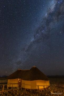 Milky Way over lodge huts.