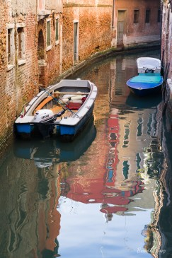 Boats, reflections and canals, Venice.