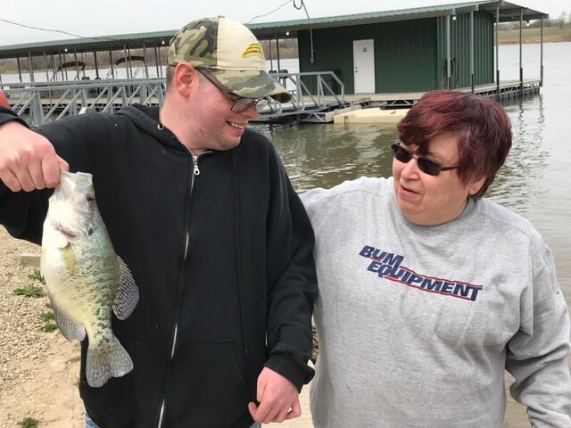 Young special-needs adult knows all about the power of fishing
