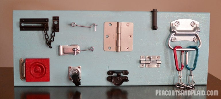 Toddler approved DIY busy latch board tutorial to keep your energetic child entertained.