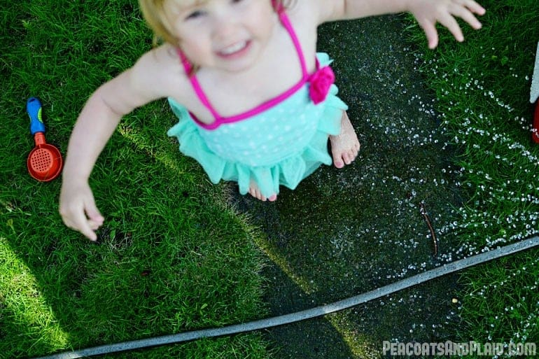 Playing in the sprinkler.