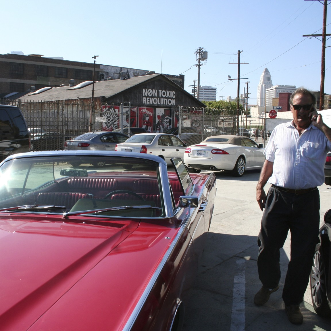 Mike Brewer, with his '66 in Downtown Los Angeles
