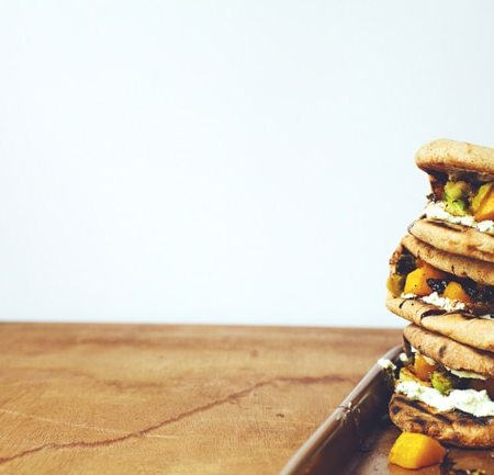 flatbread sandwich with roasted squash, brussels sprouts, honey-chive goat cheese and balsamic vinegar