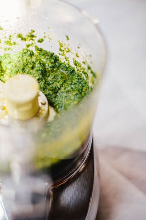 A food processor full of kale pesto.