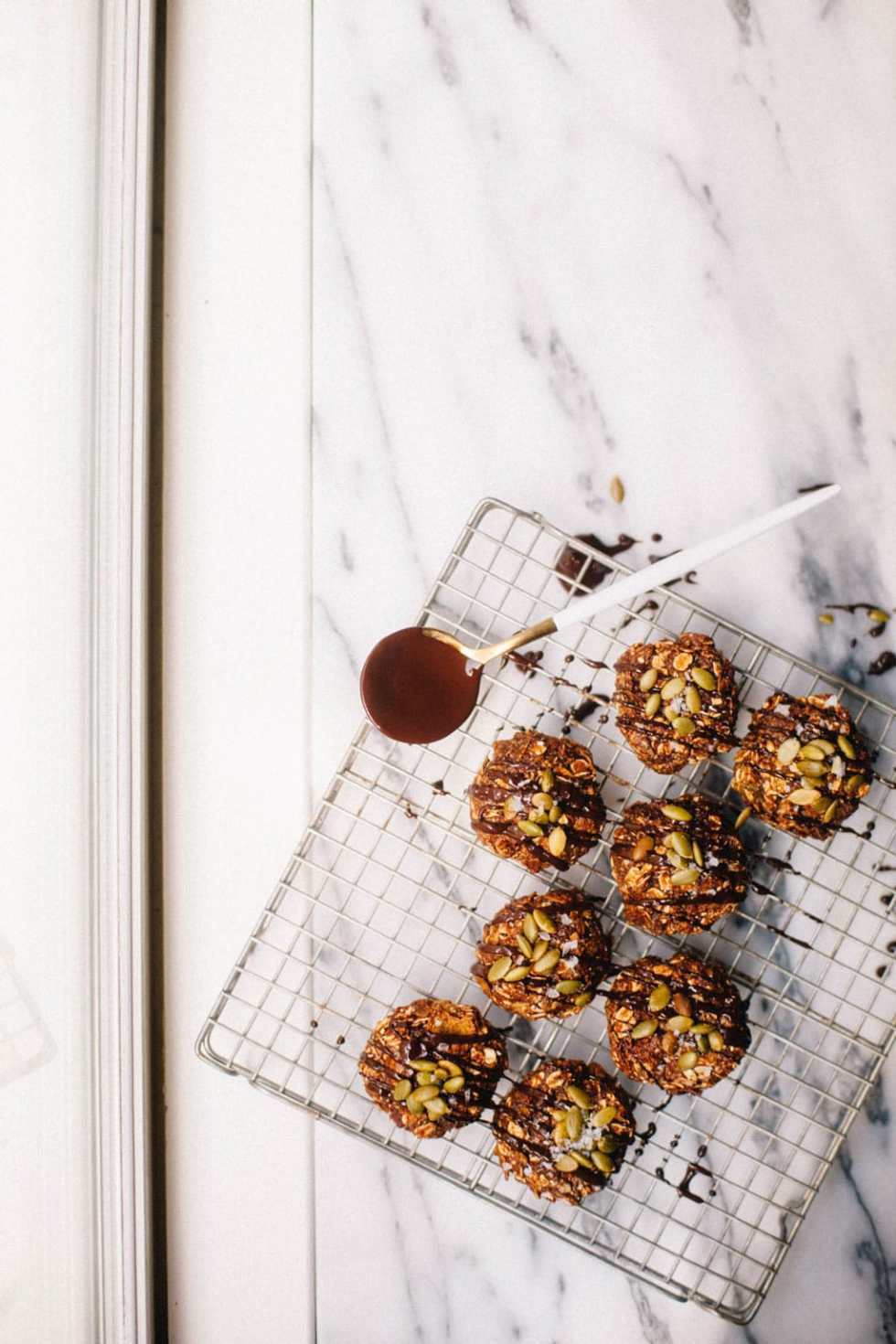 No Bake Love Crunch Cookies drizzled with chocolate and topped with pepitas
