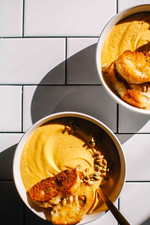 two bowls of cardamom butternut squash soup