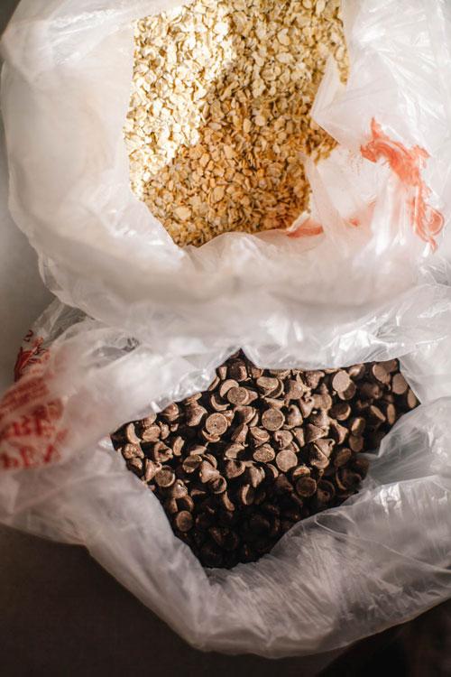 a bag of bulk oats and a bag of bulk chocolate chips