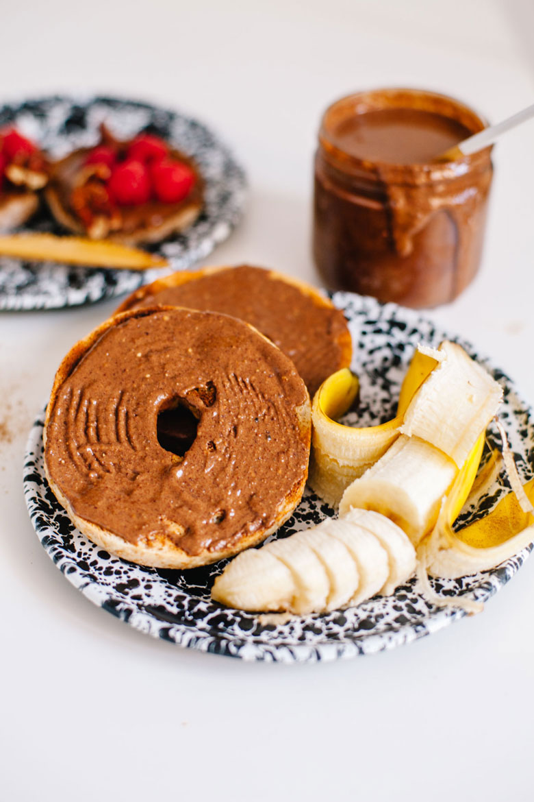 chocolate protein spread on a bagel with a banana