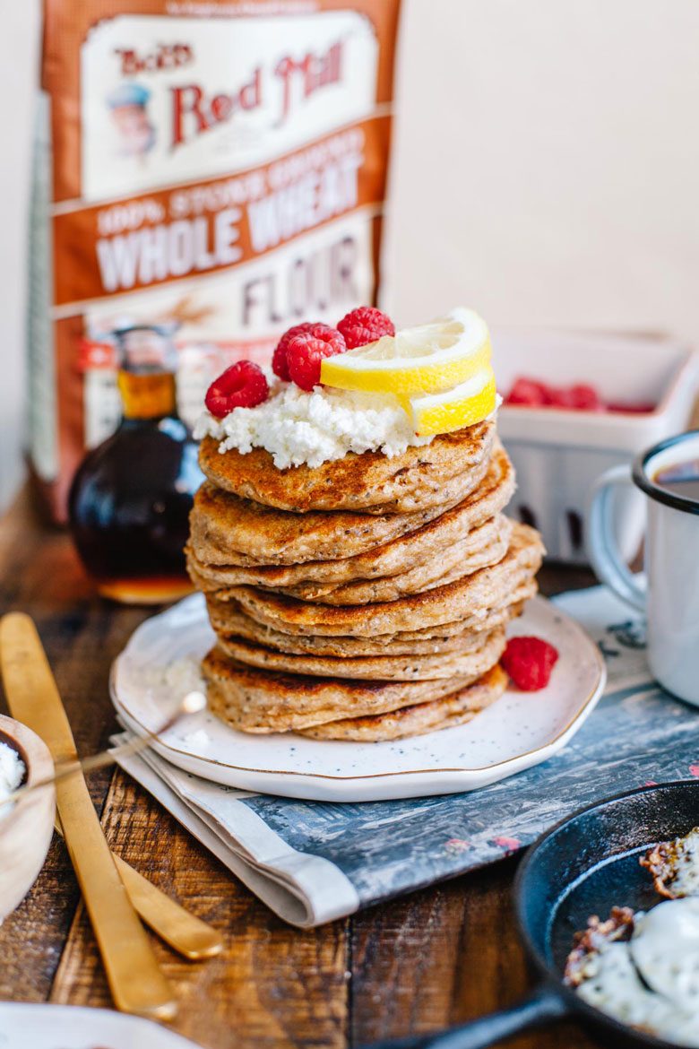 a stack of lemon chia ricotta pancakes