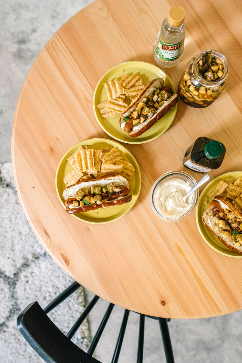 Summer Relish Veggie Dogs on plates on a wooden table