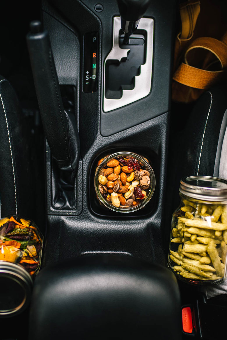 car snacks in the cup holder of your car