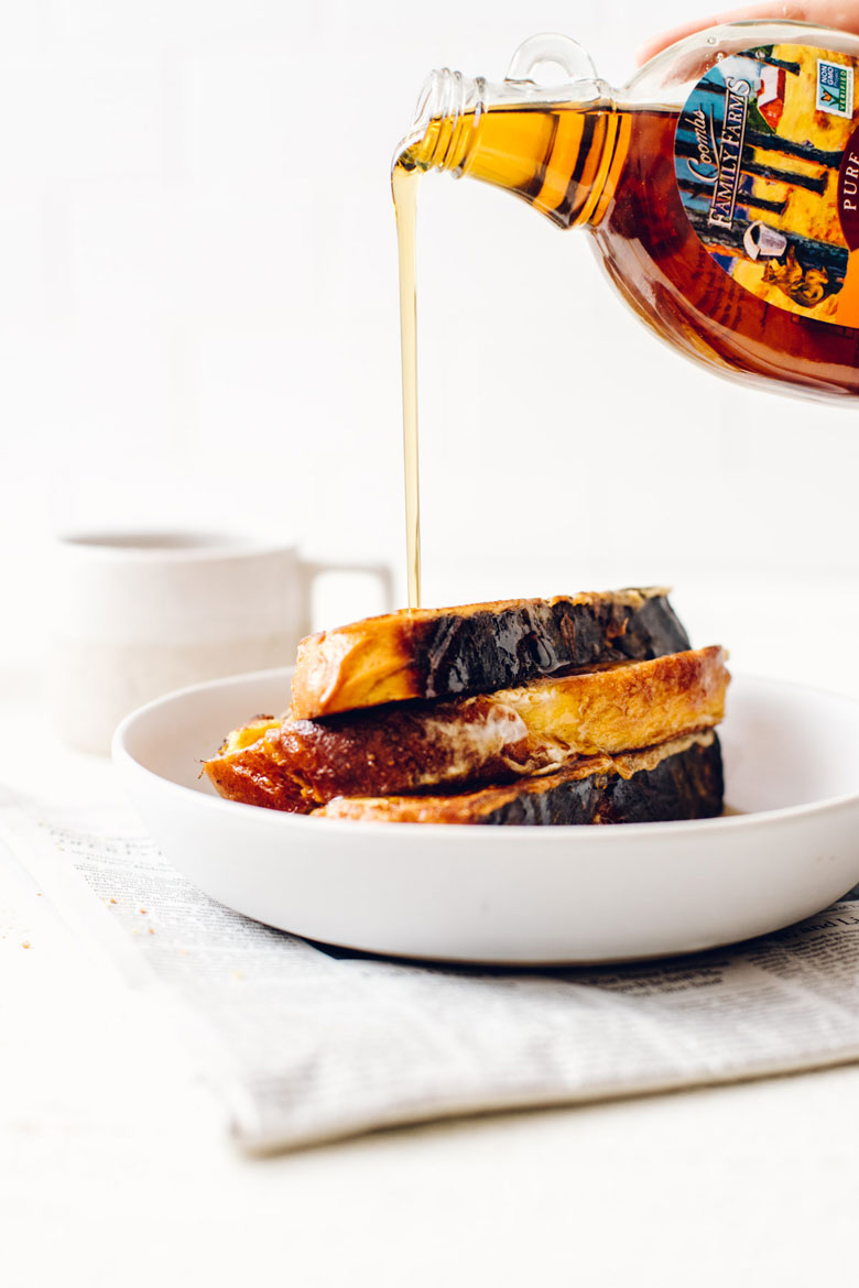 pouring Coombs Family Farms maple syrup onto maple pumpkin challah french toast