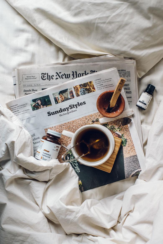 Tea, newspaper, essential oils, and palo santo