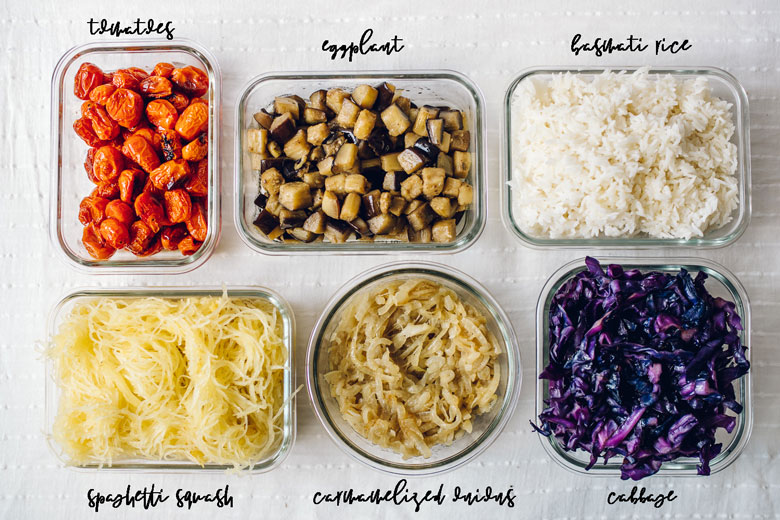 roasted tomatoes, eggplant, cooked rice, spaghetti squash, caramelized onions, and cooked cabbage all in glass containers