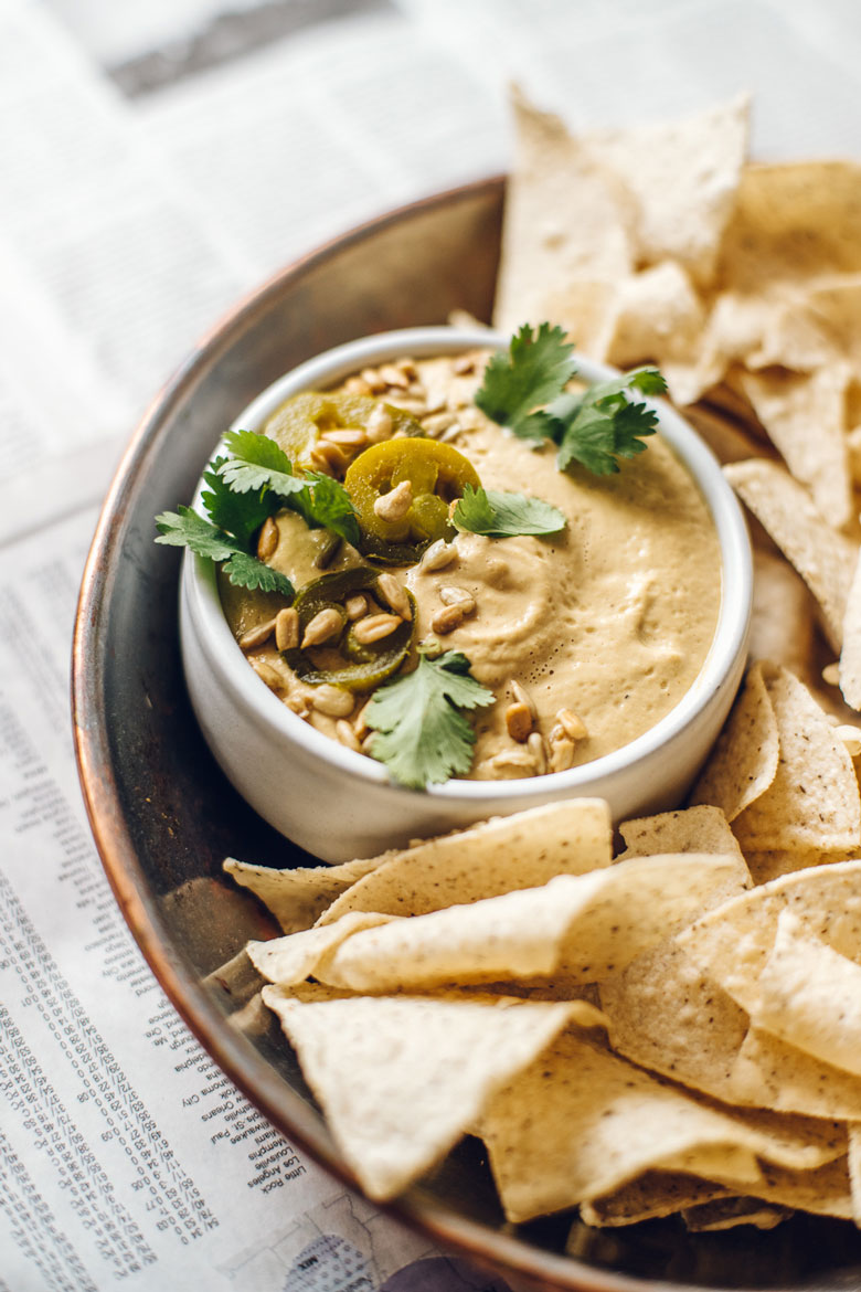 sunflower seed queso topped with jalapenos, cilantro, and sunflower seeds