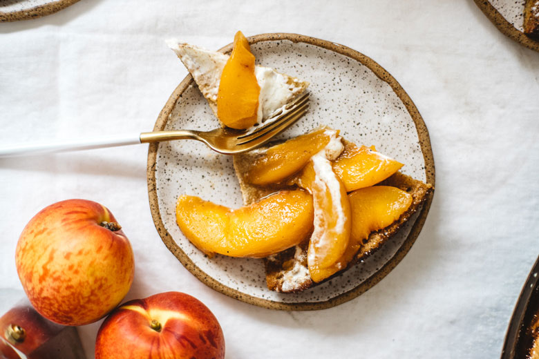 a slice of Dutch baby pancake with peach topping