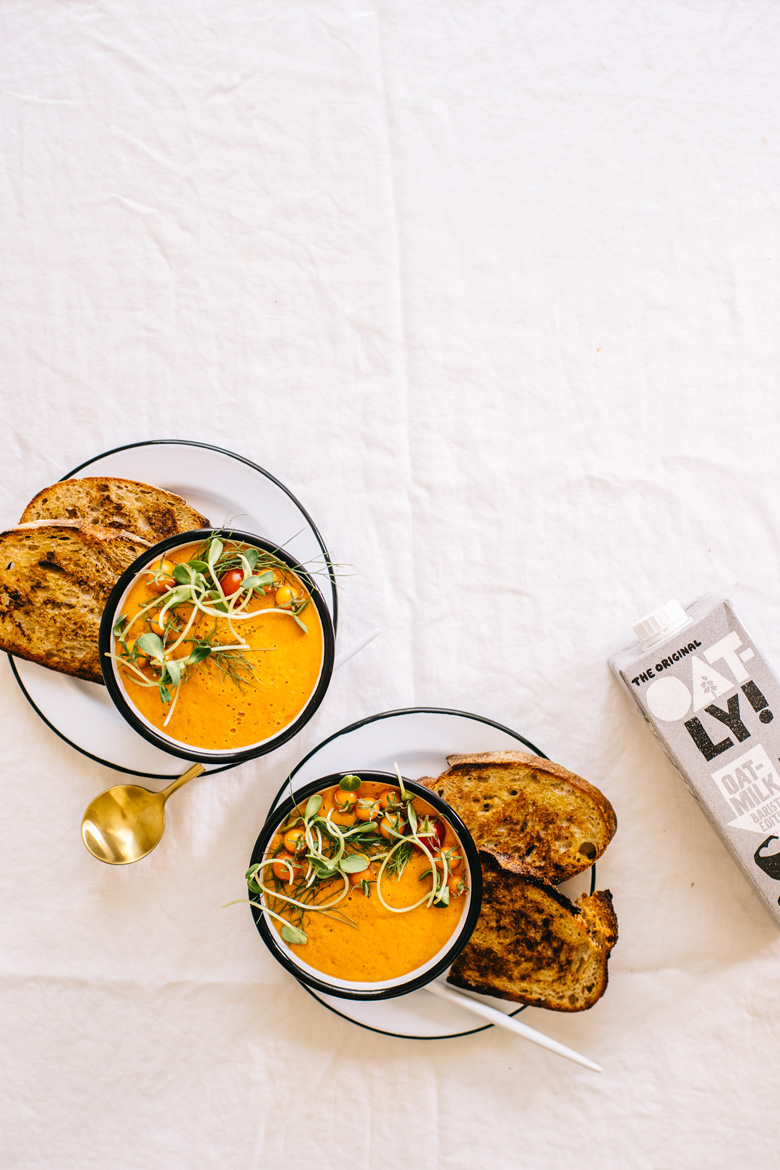 two bowls of soup with oatly