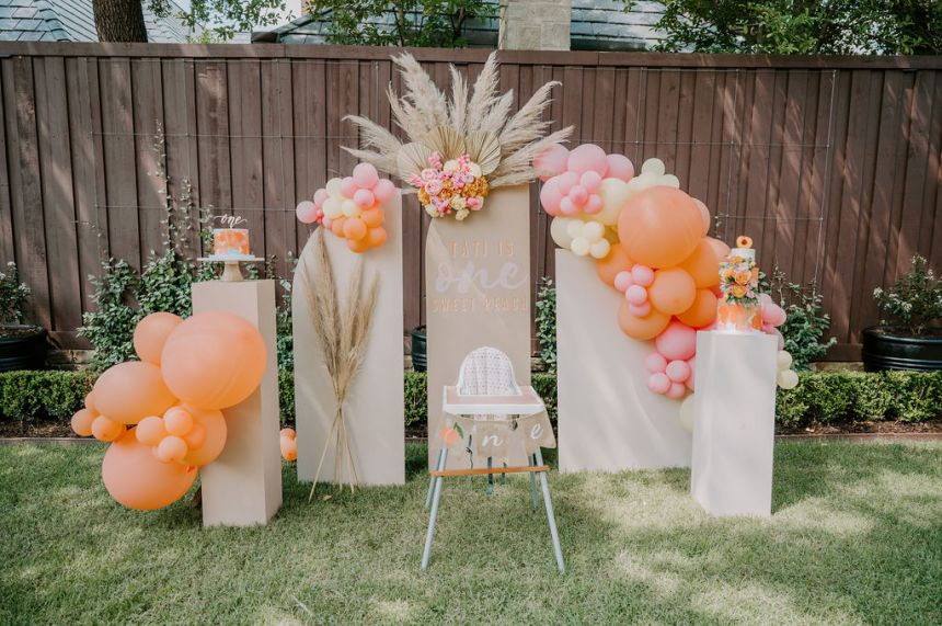 cake smash setup for one sweet peach themed first birthday party featuring The Styled Affair