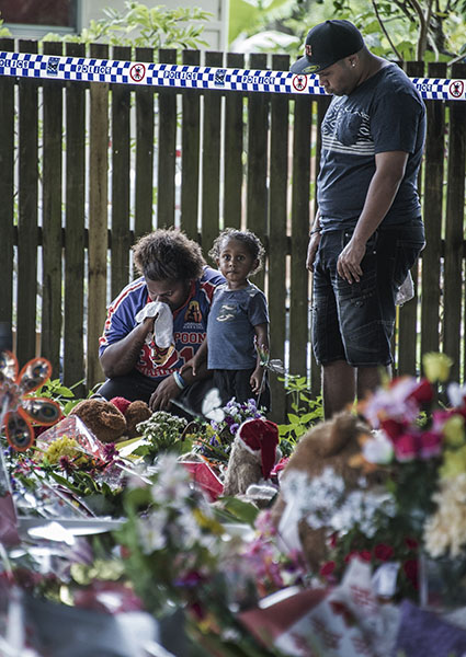 Murray Street Cairns massacre - the last remain siblings after the murder of 9 children - Norena Warria and Lewis Warria (with Norena's son Cassius) mourne at the Murray Street shrine next to the murder scene.