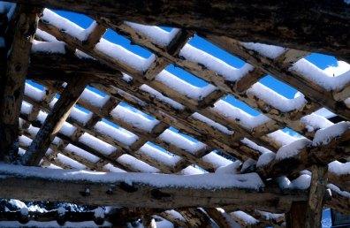 snow on timber frame
