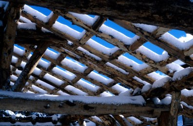 snow on timber frame