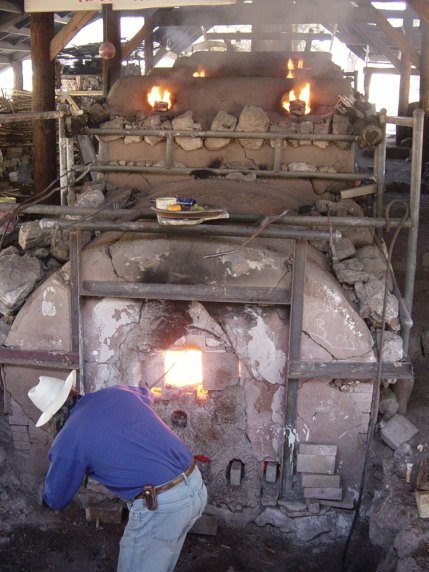 Gelinda Ferrin firing from the front of the kiln