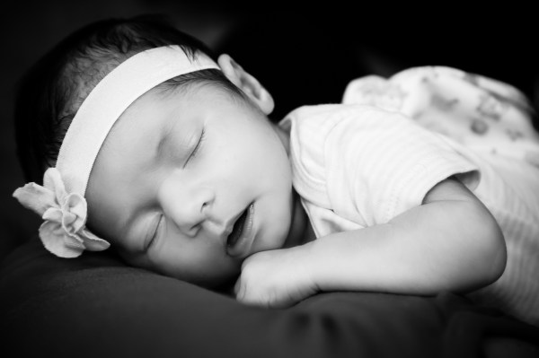 Black and white photo of newborn