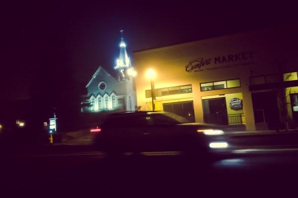 car passing through downtown Arroyo Grande at night