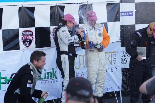 Cody Ellsworth sprays champagne on Brian Johnson & Scotty Phiel Sebring 2013 12 07