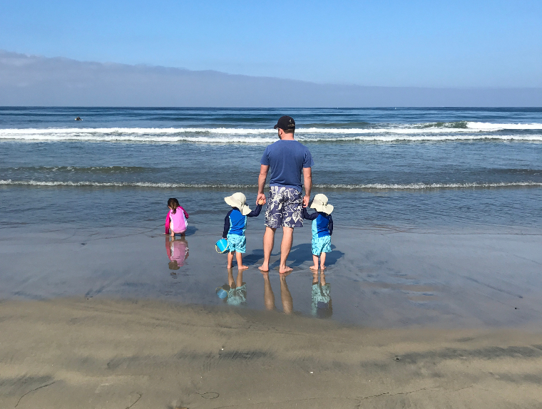 The three kids and I on the beach during our vacation to San Diego