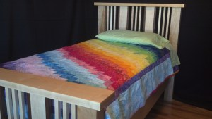 Handmade bed with handmade quilt