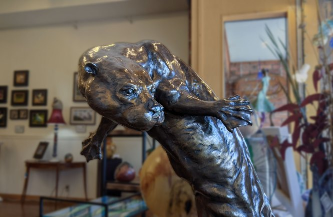 Bronze Sculpture of Otter at Hunter Wolff Gallery Old Colorado City
