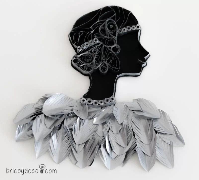figura quilling con plumas de papel