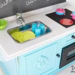 cocina de juguete con mueble de derribo