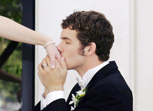 Kissing the Bride's Hand by The Wedding Traveler