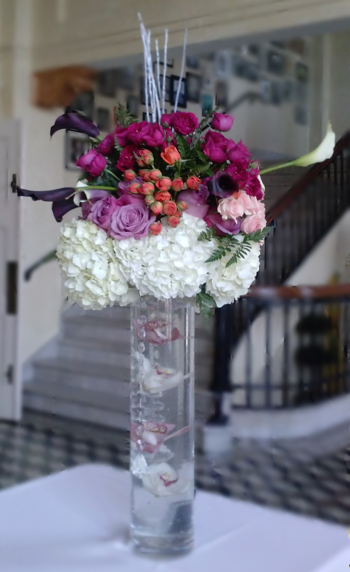 Tall Centerpiece with submerged orchids & Hydrangea, Roses, Spray Roses & Mini Calla  Lily