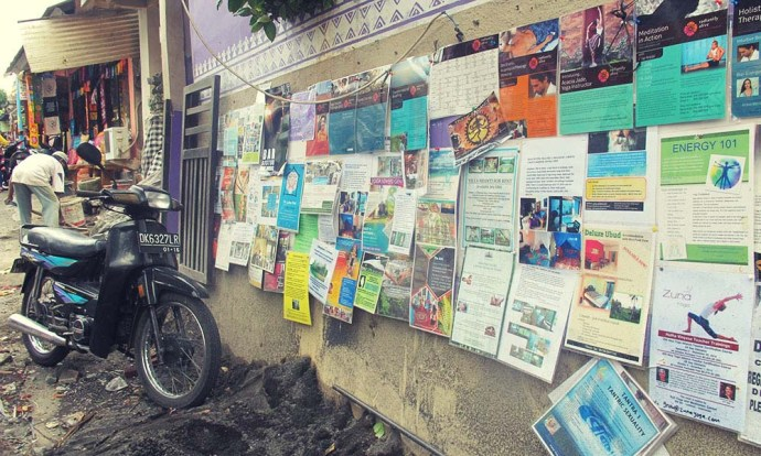 Noticeboard and motorbike in Ubud